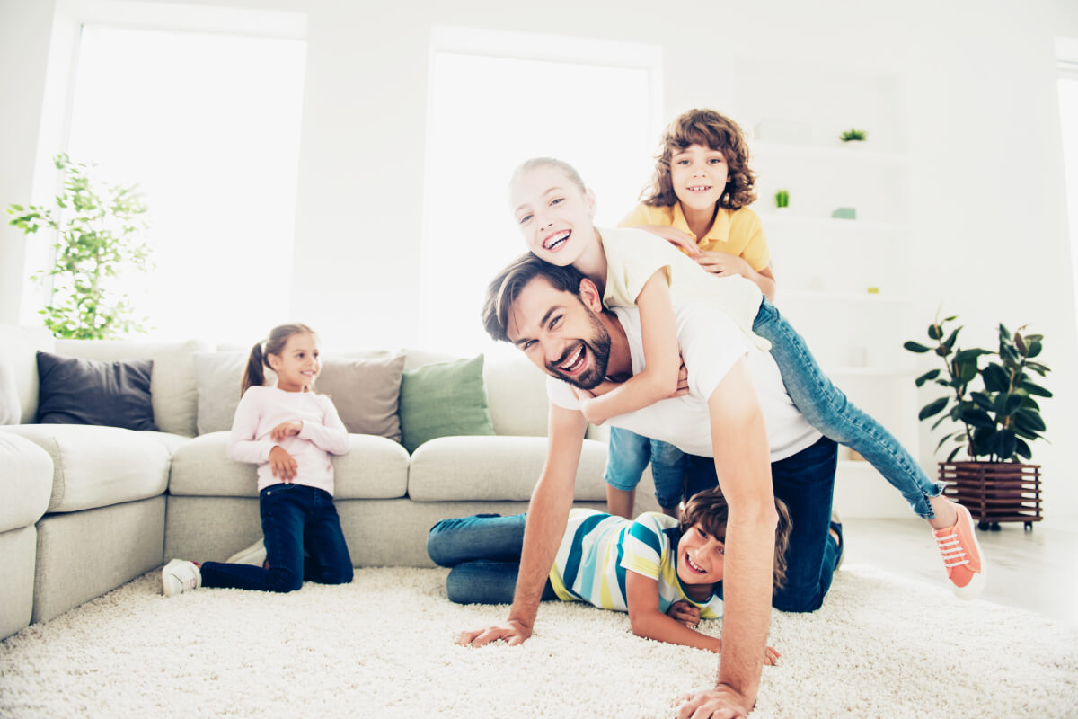 San Antonio family enjoying playing in their clean home.